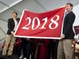 Undergraduate Council vice president Sietse Goffard '15 (at left) and president Gus Mayopoulos '15 present the freshmen with their class banner.