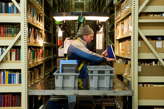 Nearly Half Of Harvards Collection Is Housed At The Harvard Depository A Marvel Efficient Off Campus Storage Library Assistant Carl Wood Reshelves
