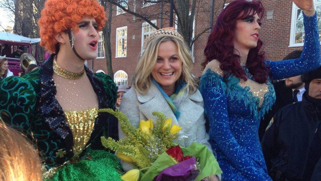 Amy Poehler with members of the Hasty Pudding Theatricals during a parade through Harvard Square