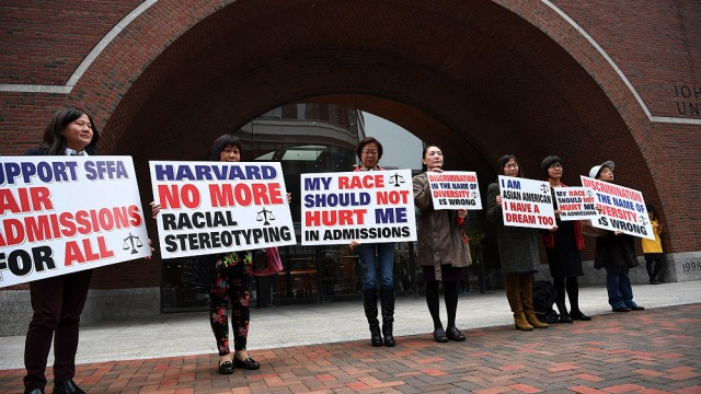 """hotograph of demonstrators in front of the federal courthouse in Boston where the SFFA v. Harvard trial took place, with signs reading """"Harvard No More Racial Stereotyping"""" and """"My Race Should Not Hurt Me In Admissions."""