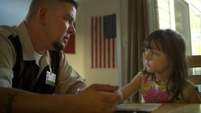 A veteran's daughter visits with her father.