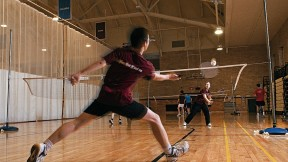 A badminton rally in progress at the Malkin Athletic Center.