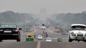 The <em>Rajpath,</em> or King's Way, in New Delhi runs from the federal government complex to the India Gate monument (seen through morning fog in the distance). It is the route for the annual Republic Day parade.