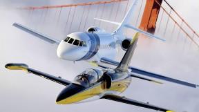 An Aero L-39 Albatros (foreground) and Dassault Falcon 2000 over the Golden Gate Bridge