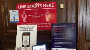 Photograph of posters displaying coronavirus rules at the entrance to Adams House dining hall.
