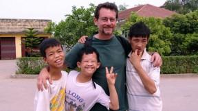 John Berlow with fellow residents of the Vietnam Friendship Village