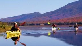 Paddlers enjoy the serenity of Flagstaff Lake, Maine.