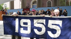 """<b>The Blue Classes:</b> The Class of 2012 has revived the """"class color"""" tradition (see """"<a href=""""http://harvardmagazine.com/2009/11/harvard-class-colors-and-trademark-clothing"""">Curious Colors</a>""""); theirs is blue. On Class Day, members of the class of 1955 displayed their class banner (also blue) to honor the graduating seniors and guest speaker Barney Frank, whose College class (1961) is blue, too."""