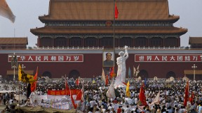 Tiananmen Square on May 28, with the student-made Goddess of Democracy statue facing the portrait of Mao Zedong, China's revolutionary founder