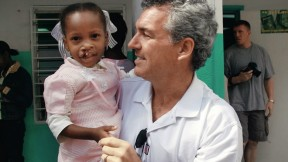 """Brian Mullaney with a Haitian patient before her surgery this past February. Smile Train has provided roughly 160 surgeries in Haiti and recently launched """"Cleft-free Haiti"""" to completely eradicate cleft there."""