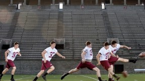 "In Harvard Stadium, David Mothander practices a kickoff, using the ubiquitous ""soccer-style"" kicking technique. Scroll down for a <a href=""#placekick"">video.</a></p>"