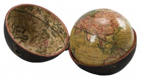 A photograph of an eighteenth-century, three-inch pocket globe in its open case