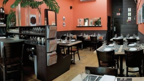 """Among Vee Vee's charms are its boldly colored walls (Benjamin Moore's """"Autumn Cover""""), a signature touch for co-owner Kristen Valachovic, an interior designer before restaurant life took hold."""