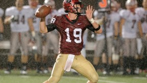 Backup quarterback Colton Chapple ably directed the Crimson offense in a 24-7 victory over Brown, completing 15 passes for 207 yards and two touchdowns in a rainstorm.