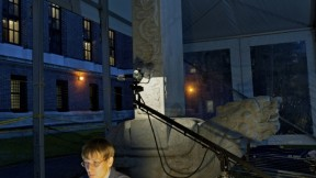 The Peabody Museum's Alexandre A. Tokovinine, a lecturer on anthropology and research associate, is shown at work within a protective tent during the scanning of the Chinese stele—conducted at night for optimal results.