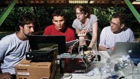 Bernardo Flores, Rafael  Tapajós, and Hannah Horowitz '11 learn how to analyze data  gathered from a weather balloon under the supervision of  Professor Steven Wofsy
