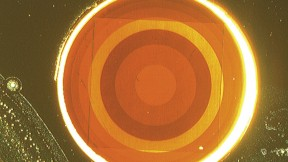 This disortion-free flat lens, less than a millimeter across, uses antennae etched from a layer of gold, rather than glass, to focus laser light.