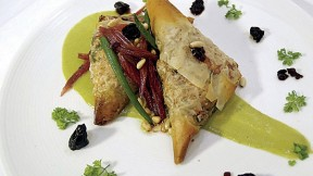 From the menu: phyllo triangles filled with caramelized onions, chard, and tofu, in a sorrel cream sauce