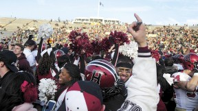 Harvard followers stormed the field at Yale Bowl to join players celebrating the Crimson's seventh straight victory over the Blue.