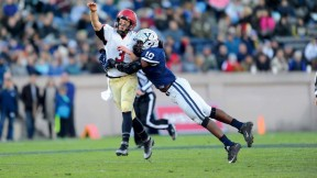 Despite the efforts of Yale linebacker Victor Egu, Crimson quarterback Scott Hosch '16 managed a flip to freshman receiver Justice Shelton-Mosley, who took the ball the rest of the way. The 35-yard touchdown gave Harvard a 14-7 second-quarter lead in The Game.