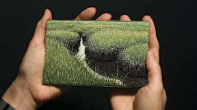The artist holds <i>Summer Salt Marsh</i> (2008).