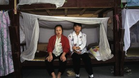 Factory girls in their dormitory, Guangdong Province