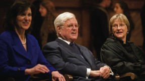 Senator Edward M. Kennedy, his wife, Victoria Reggie Kennedy, and President Drew Faust. Members of the Kuumba Singers appear in the rear.
