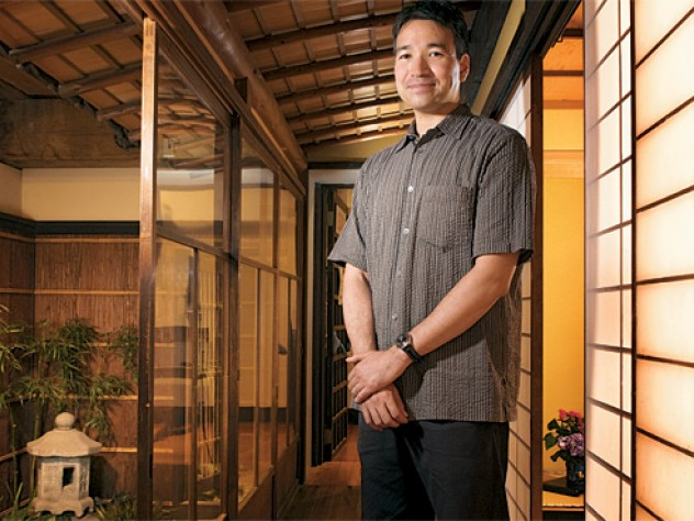 Art historian Yukio Lippit in the Japanese merchant's house at the Boston Children's Museum.