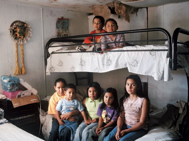 Seven Mexican immigrant children inside an old mobile home, where they live with their single mother in Mission, Texas