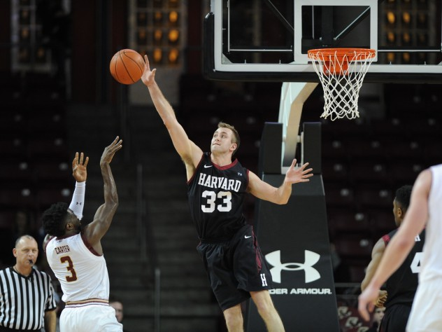 Captain Evan Cummins '16 (also shown in action against BC) blocked three Dartmouth shots and scored 10 points in the win over the Big Green.
