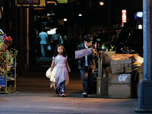 A production still from <i>Children of Invention,</i> with Crystal Chiu as Tina and Michael Chen as Raymond