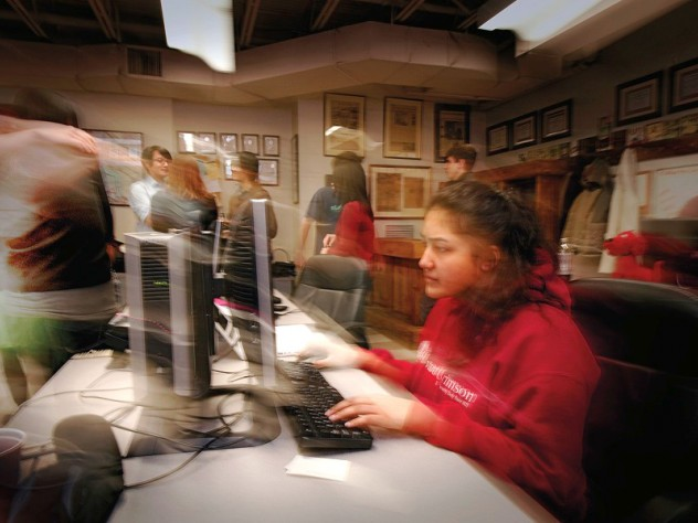 Late at night, Harvard Crimson staffers put to bed the last issue before winter break.