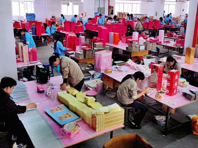 Shenzhen: leased migrant workers (in blue clothes) at a paper factory in the booming southern Special Economic Zone