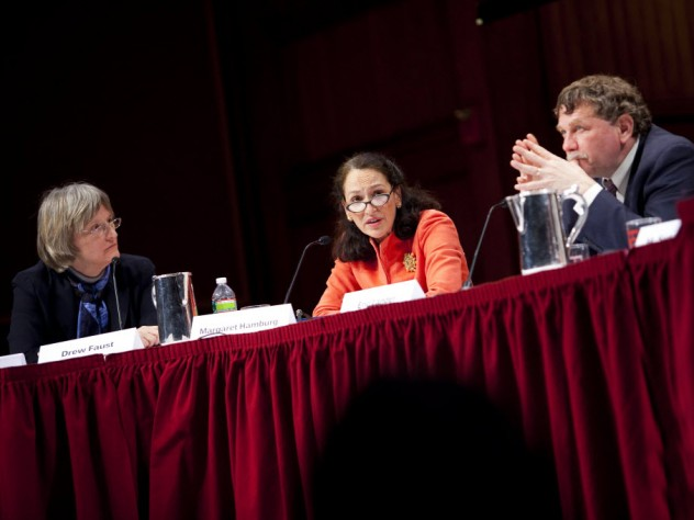 President Drew Faust moderates a February 22 discussion of the human genome map's impact in the 10 years since its first publication. Also shown are panelists Margaret Hamburg '77, M.D. '83, commissioner of the U.S. Food and Drug Administration, and Eric Lander, president and founding director of the Broad Institute of Harvard and MIT and professor of systems biology at Harvard Medical School.