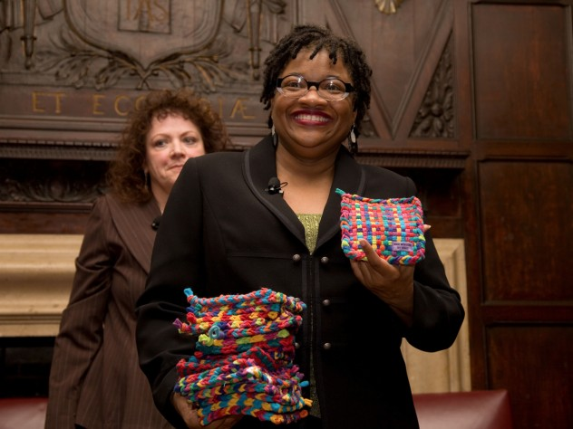 Beverly McIver with potholders made by her sister, Renée, at the Harvard Club of New York event. Filmmaker Jeanne Jordan is in the background.