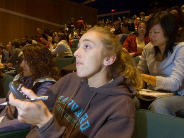 ...while Julia Pederson '07 registers her answer with a handheld clicker...