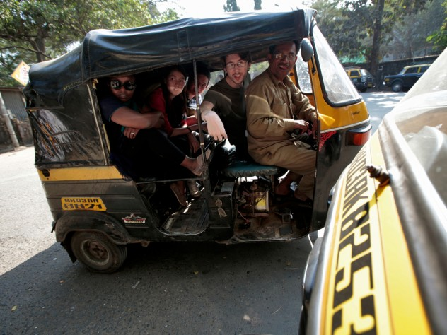 Gitangu, Ayuningtyas, Abdul Rahman, and Potter cram into an auto-rickshaw for the ride back to their hotel at the end of the day.