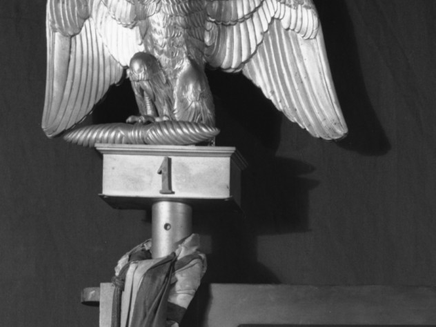 Finial in the form of an eagle. Gilt metal (bronze), French, 1813–1814, approximately 10 inches high. This originally sat on the top of the pole support of a silk Napoleonic flag in the Short Gallery. The flag was not taken by the thieves. The finial is made of bronze, but may have had the appearance of gold to the thieves.