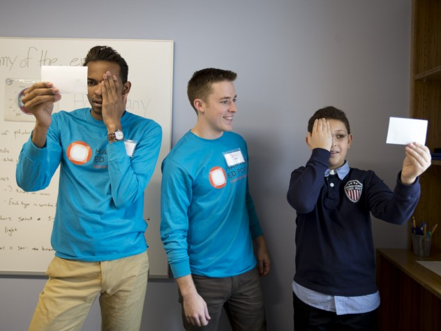 In one of the Ed Portal's new mentoring spaces, Christ White '15 (center) teaches fellow undergraduate Tyreke White '15 and 12-year-old Allston resident Mehdi Kayi about optical illusions.
