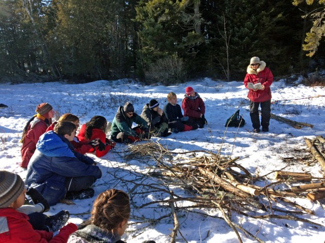 During downtime, students listen to guide Polly Mahoney read about life in the wilderness.