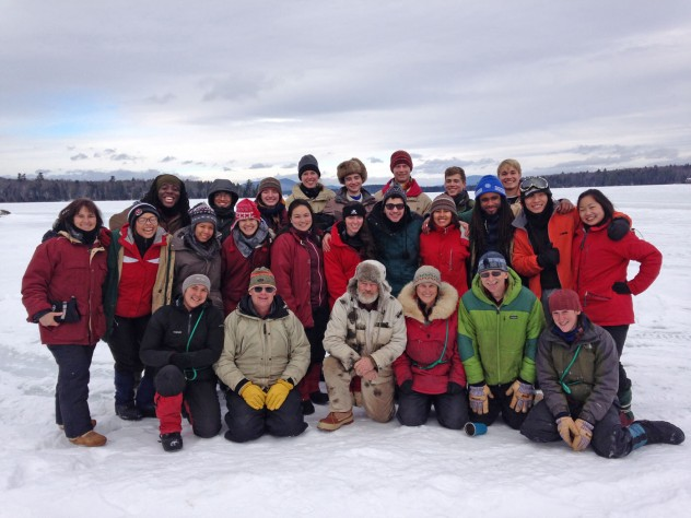 Students, guides, and House Master Anne Harrington (far left) pose on the frozen lake.