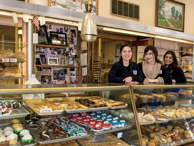 Alejandra Ramirez, Olivia Hitchens, and Gabriela Ramirez (from left to right) preside over the goods at Antoine's Pastry Shop in Newton.
