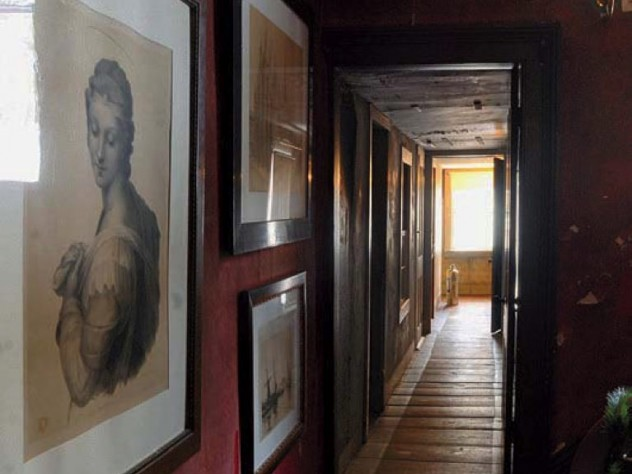 A hallway with hanging artwork in The Evergreens