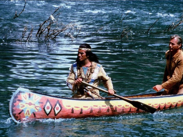 Movie still showing Winnetou and Old Shatterhand paddling a canoe