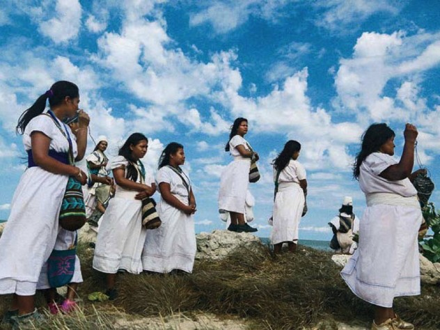 Women making offerings to the Magdalena River in Colombia
