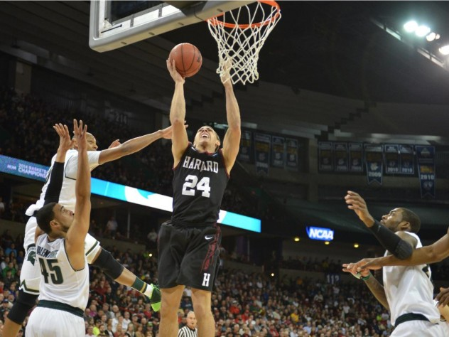 Harvard's Jonah Travis goes up for a layup.