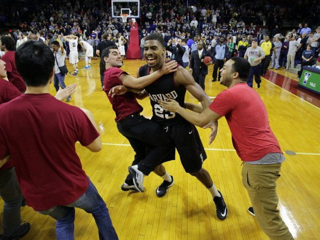 After the game, Wesley Saunders '15 and his teammates could finally relax (and celebrate) as the Harvard student section stormed the floor.
