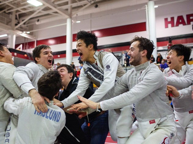 The Harvard men celebrate their championship win.