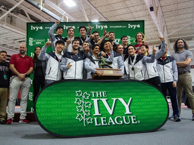 The Ivy champion men pose with their first-place trophy.