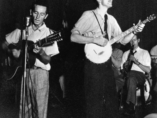 Woody Guthrie (left) and Seeger in 1941; they first met in 1939.